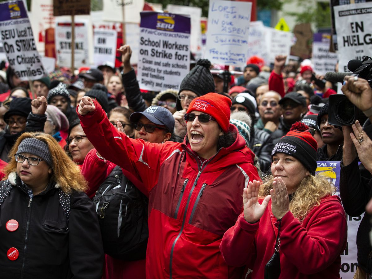 Thousands of striking Chicago Teachers Union and SEIU Local 73 members and their supporters rally at the Thompson Center after marching around City Hall during Mayor Lori Lightfoot's first budget address during the monthly Chicago City Council meeting.