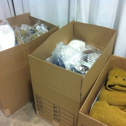 Tons of boxes full of knits, ready to replenish racks