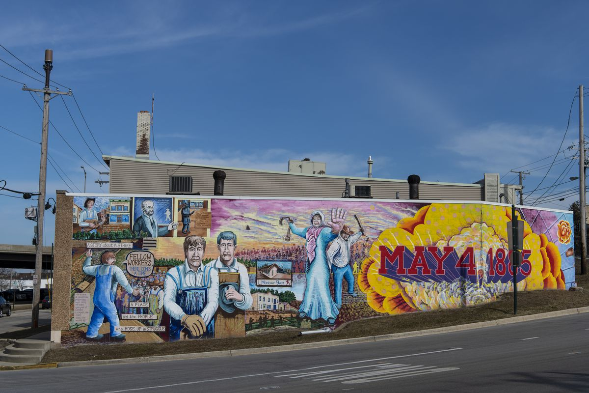 """The mural titled """"There Comes a Time"""" in the 100 block of Main Street in Lemont memorializes a deadly clash between quarry workers and militia in 1885."""