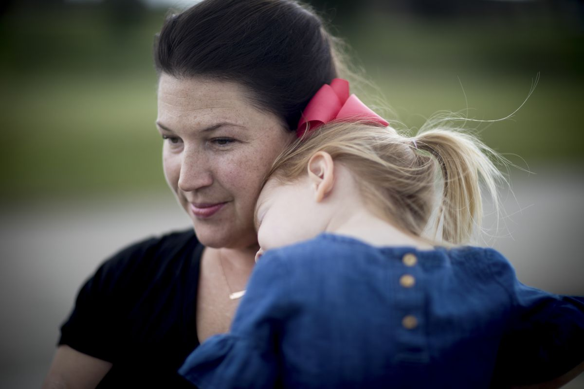 Lindsay Clark and her daughter Lily outside their home in Aledo, Texas.