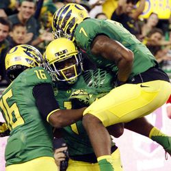 Oregon Receiver Josh Huff, middle, celebrates his touchdown with teammates Daryle Hawkins, left, and Keanon Lowe during the first half of their NCAA college football game against Arkansas State in Eugene, Ore., Saturday, Sept. 1, 2012.