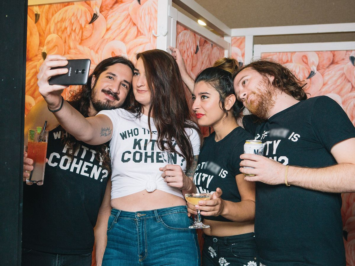 """Taking a bathroom selfie at Kitty Cohen's while wearing """"Who the f**k is Kitty Cohen?"""" shirts"""