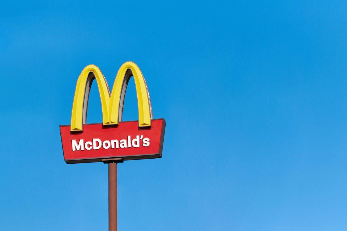 McDonald sign board, blue sky background.