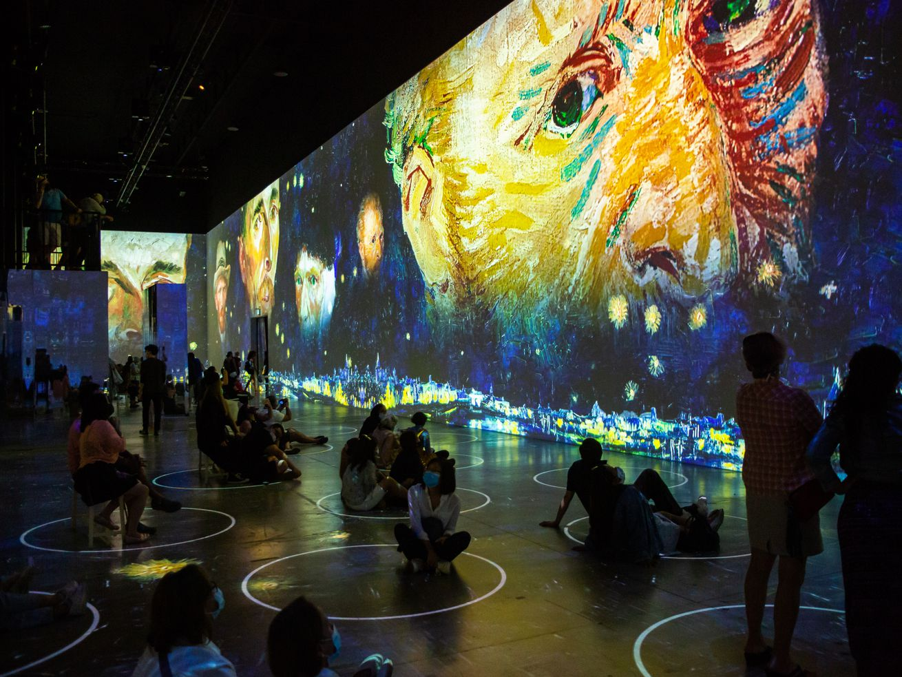 """Visitors are surrounded by projections at """"Immersive Van Gogh."""""""