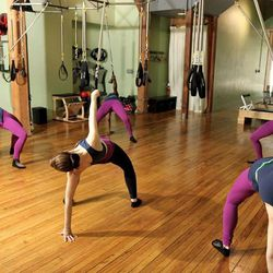 """<b>Informed Technique—</b>If you've ever thought becoming a marionette for a little while might be fun, <a href=""""http://informedbody.com"""">Informed Technique</a> is for you. The Pilates and ballet-inspired fitness class uses custom suspension system with s"""