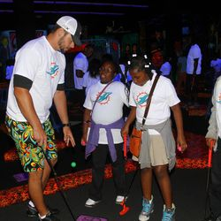 Brandon Fields with students from Henry S. Reeves Elementary at Monster Mini Golf in Miramar