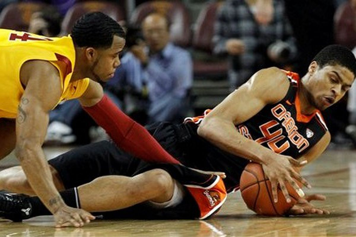 Oregon St.'s Devon Collier wrestles the ball from USC's Donte Smith.  <em>(Photo by Chris Carlson, AP)</em>