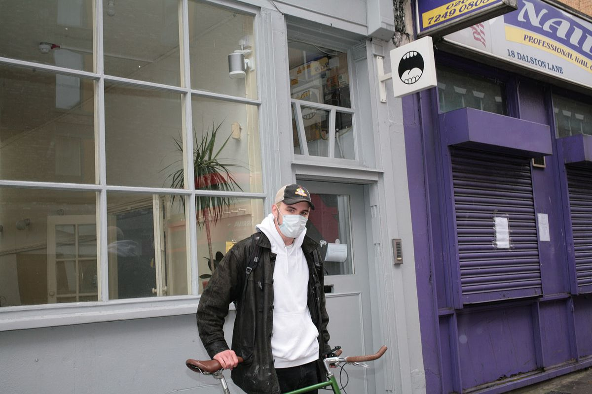 Sam Napier mid-delivery in Dalston, east London, during lockdown. He hand-delivered over ten thousand flour tortillas to addresses in Hackney during the novel coronavirus lockdown.