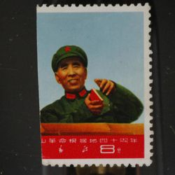 """FILE - In this Jan. 27, 2010 file photo, Lin Biao, the second-in-charge after Chairman Mao Zedong, is shown in the right half of the unissued 1967 commemorative stamp for 40th anniversary of establishment of Jing Gangshan Revolutionary Base displayed during a stamp auction review in Hong Kong. The missing left side of the stamp showed Mao. Once designated as Mao's """"closest comrade in arms"""" and hand-picked to be his successor, Lin dropped from view in September 1971 amid the radical turmoil known as the Cultural Revolution. Turns out he had died. The government started telling ordinary Chinese about his death only two months later; some accounts say it was 10 months later."""