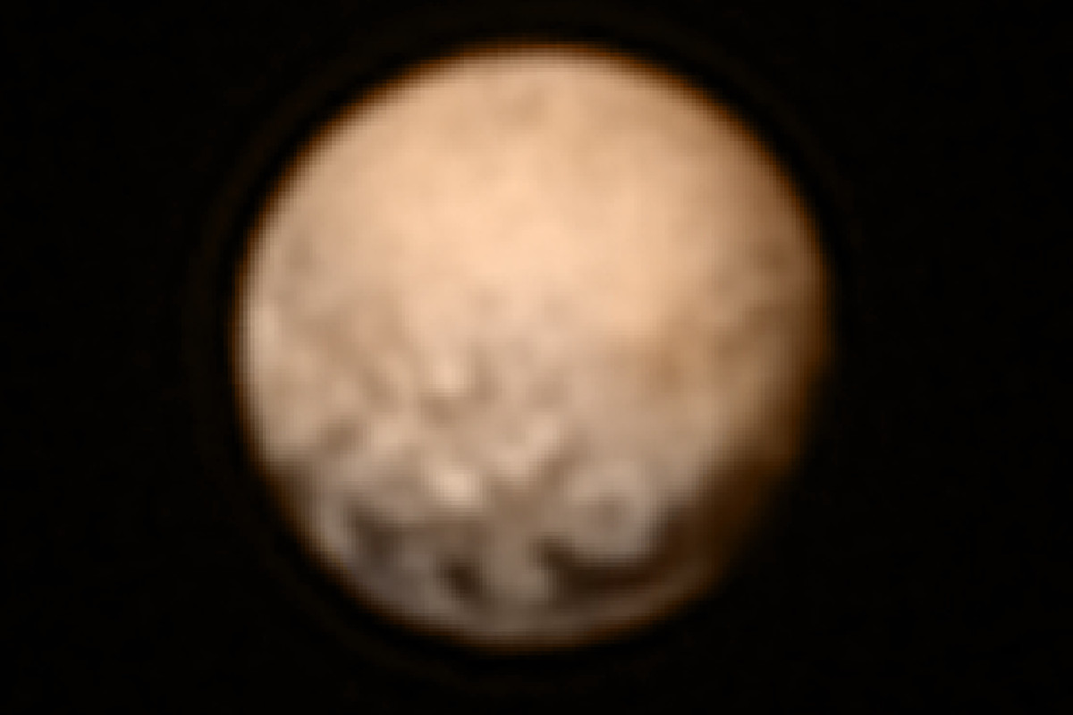Pluto, as photographed by New Horizons from 8.3 million miles away.