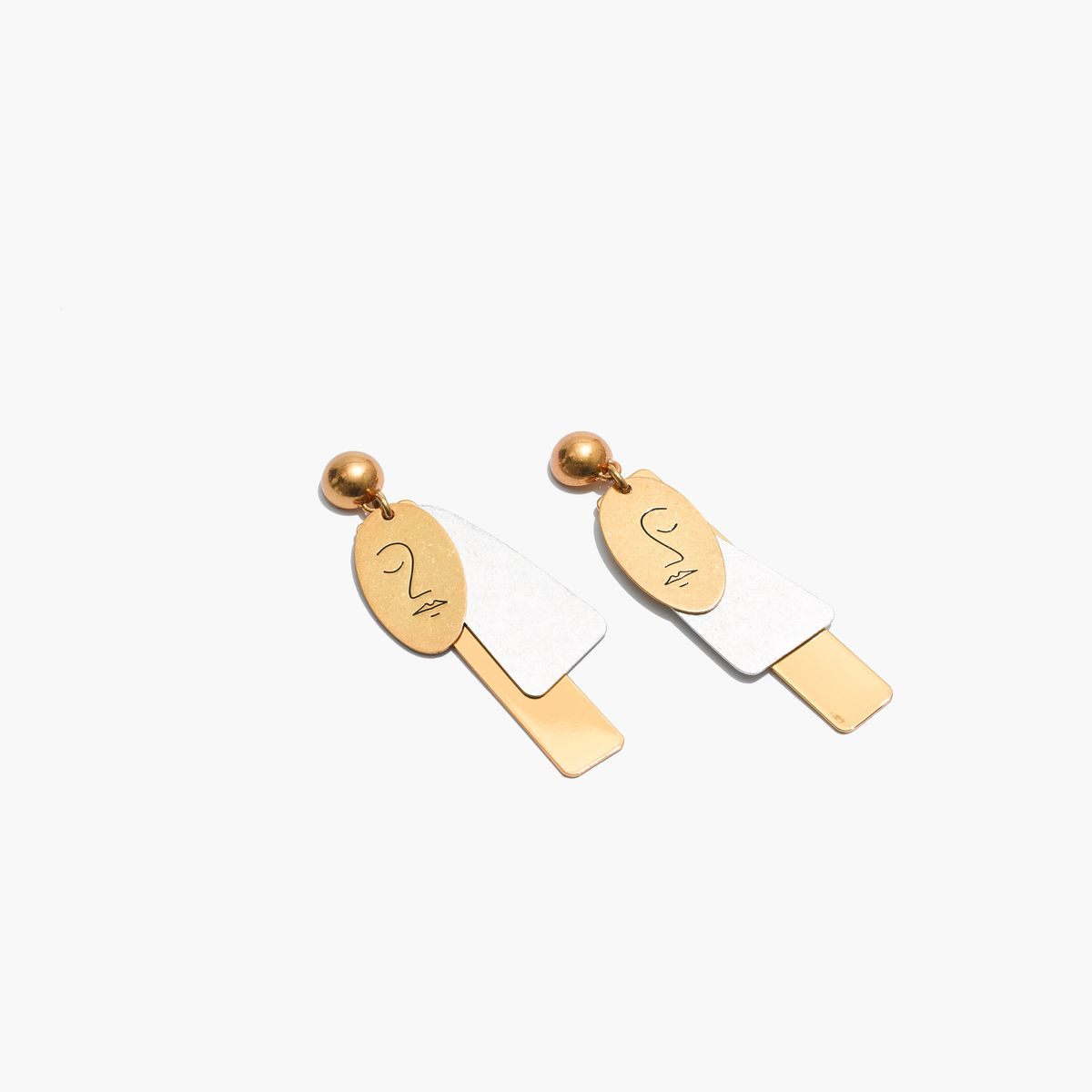 Gold and silver earrings.