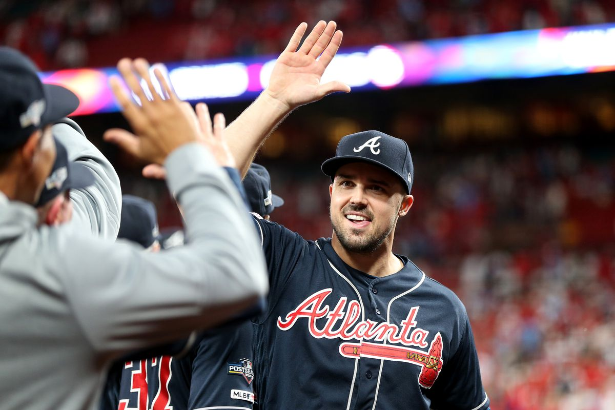 Adam Duvall of the Atlanta Braves celebrates with his teammates after their 3-1 win over the St. Louis Cardinals in game three of the National League Division Series at Busch Stadium on October 06, 2019 in St Louis, Missouri.