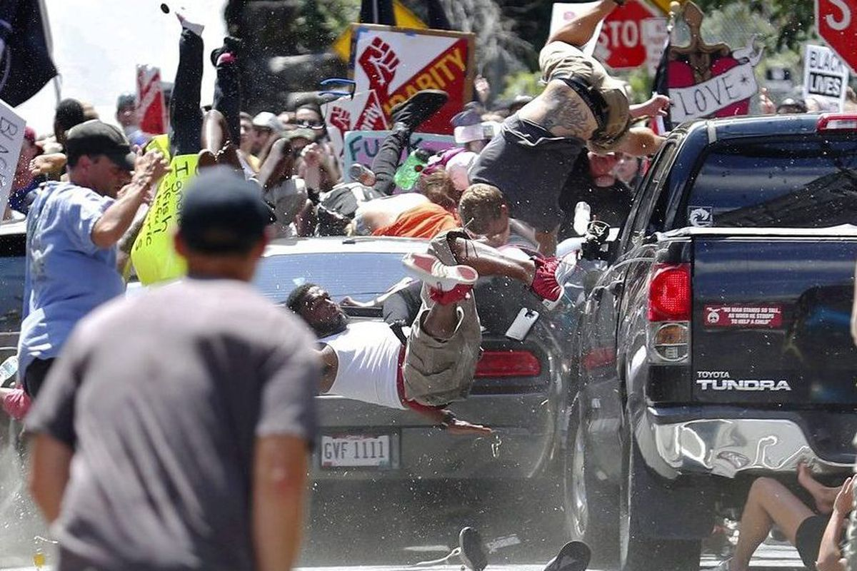 A car drives through a crowd of counterprotesters in Charlottesville, Virginia, in August 2017.
