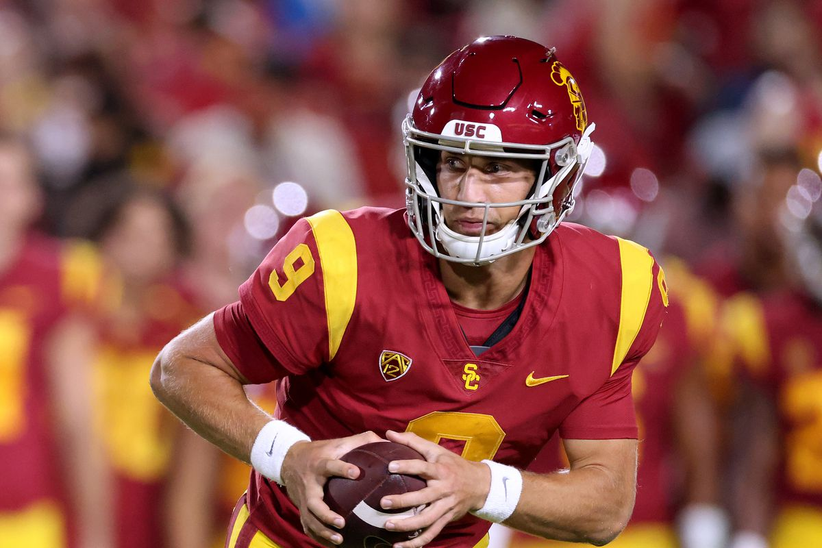 Kedon Slovis #9 of the USC Trojans rolls out of the pocket during the second quarter against the Stanford Cardinal at Los Angeles Memorial Coliseum on September 11, 2021 in Los Angeles, California.