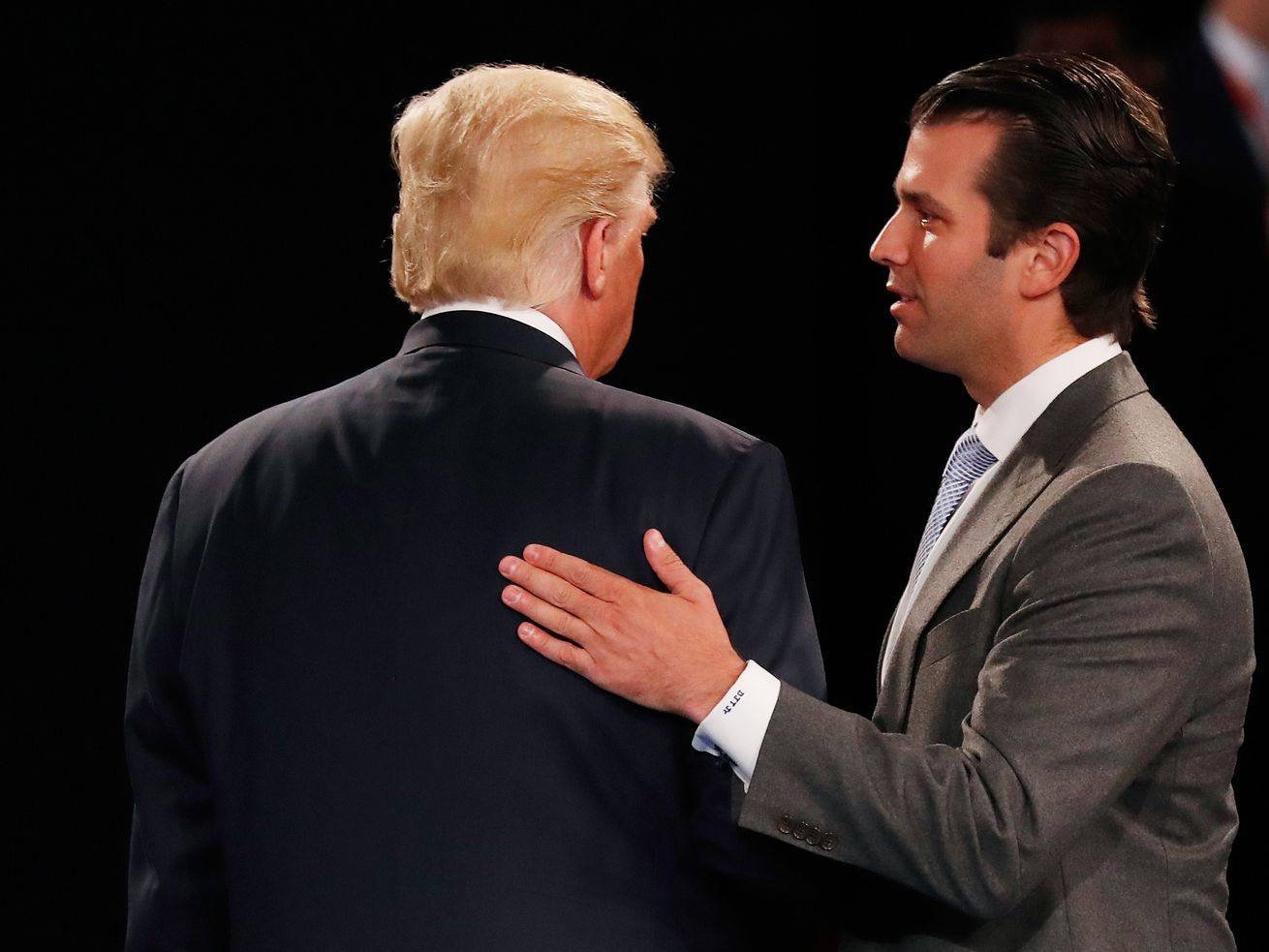President Donald Trump and his son Donald Trump Jr. at a Republican presidential debate in 2016.