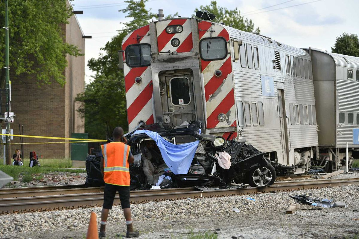 Two adults and a child were killed after a Metra train struck their vehicle Sunday afternoon 103rd and Vincennes, authorities said./ Tyler LaRiviere