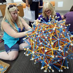 Rebecca Benson and Kathryn Van Wagoner, director of developmental mathematics, build a model of a mathematical shape out of Zometool during the grand opening of the new Tracy Hall Science Center at Weber State University in Ogden on Wednesday, Aug. 24, 2016.