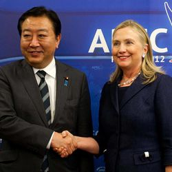 U.S. Secretary of State Hillary Rodham Clinton, right, and Japanese Prime Minister Yoshihiko Noda, shake hands during a bilateral meeting during the Asia-Pacific Economic Cooperation (APEC) Summit in Vladivostok Saturday, Sept. 8, 2012.
