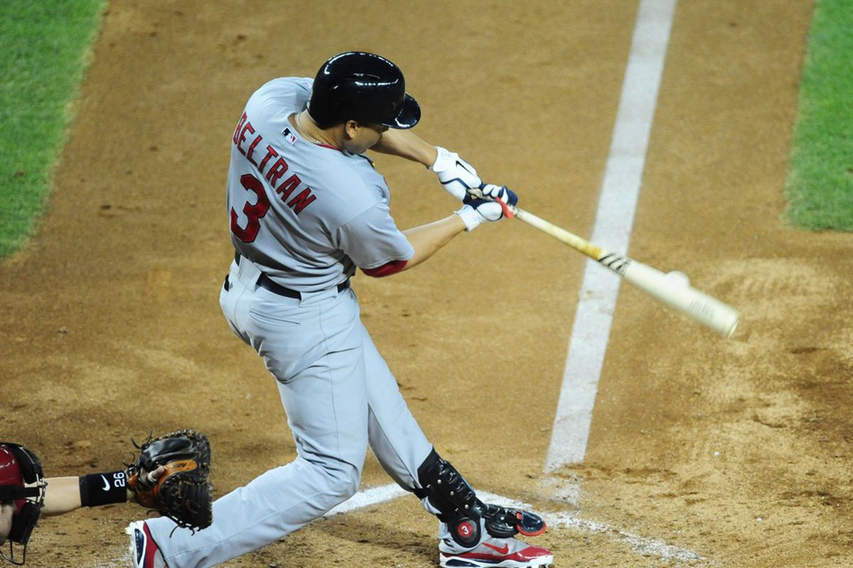 May 9, 2012; Phoenix, AZ, USA; St. Louis Cardinals batter Carlos Beltran hits an RBI single in the fifth inning against the Arizona Diamondbacks at Chase Field. Mandatory Credit: Mark J. Rebilas-US PRESSWIRE