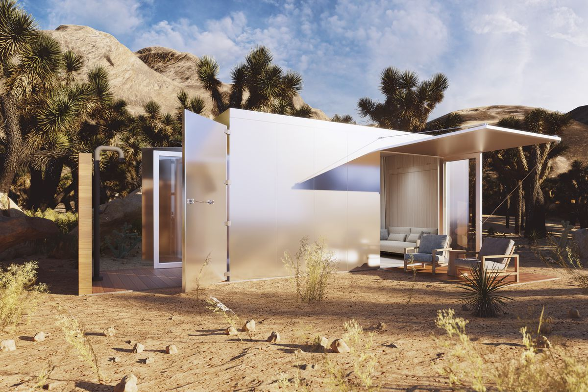 Rendering of tiny home with metal panels in a desert setting.