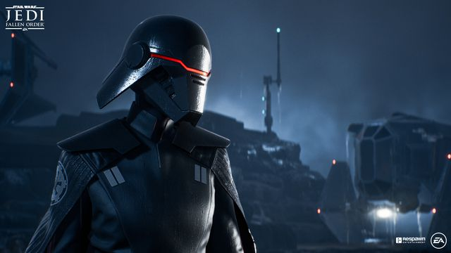 An ominous figure in a black mask and Imperial uniform looks to the left