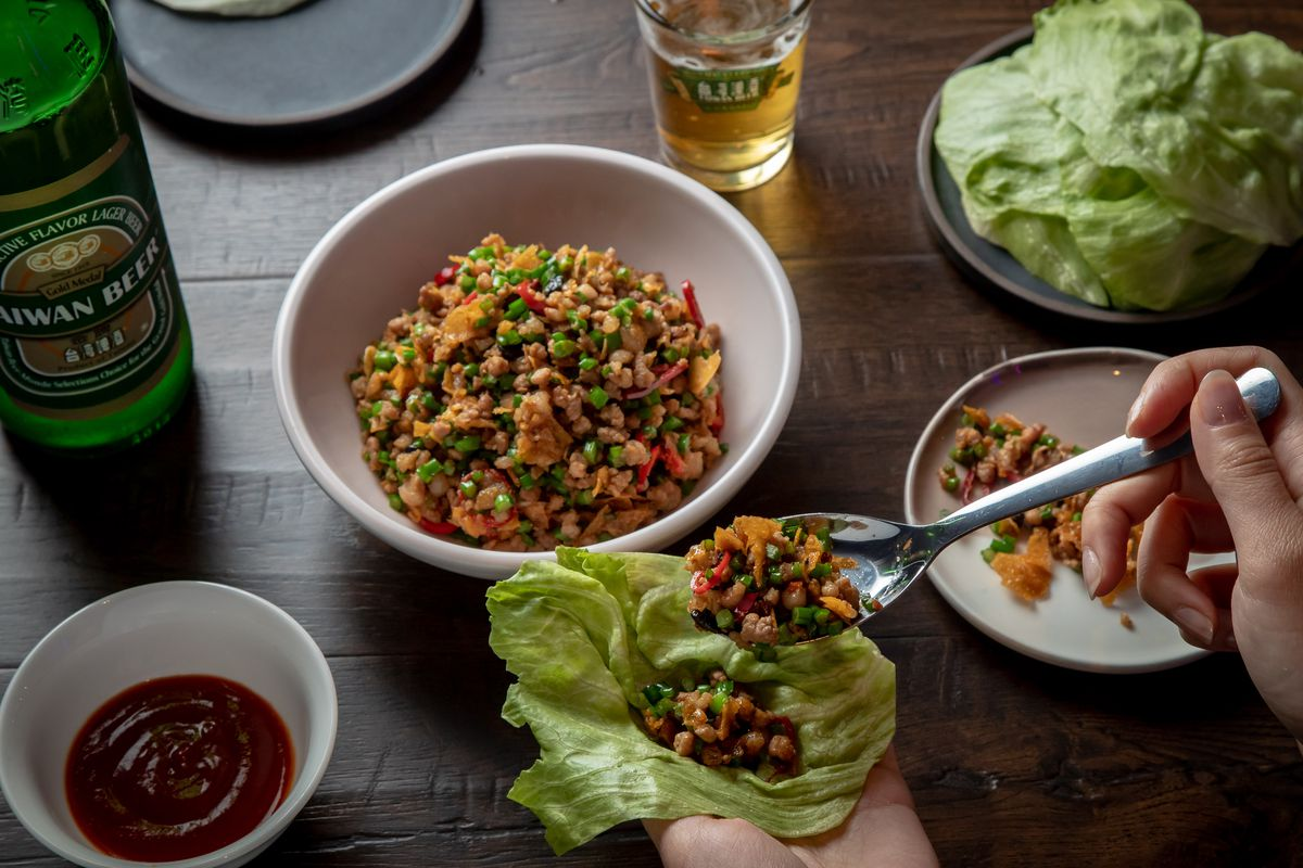 Lettuce cups with pork, chives, chili, fermented black bean, and shaoxing at 886