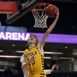 Loyola's Bennett Kwiecinski (15) scores against St. Ignatius in their 56-46 win at Northwestern University in Evanston, Friday, February 8, 2019.   Kevin Tanaka/For the Sun Times