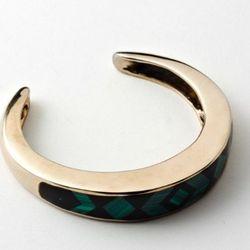 Inlay cuff in bronze, malachite, and onyx.