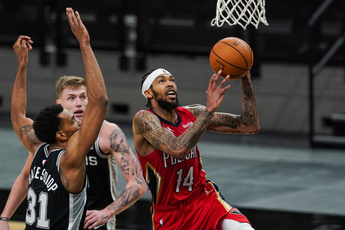 New Orleans Pelicans forward Brandon Ingram (14) shoots in the second half against the San Antonio Spurs at the AT&T Center.