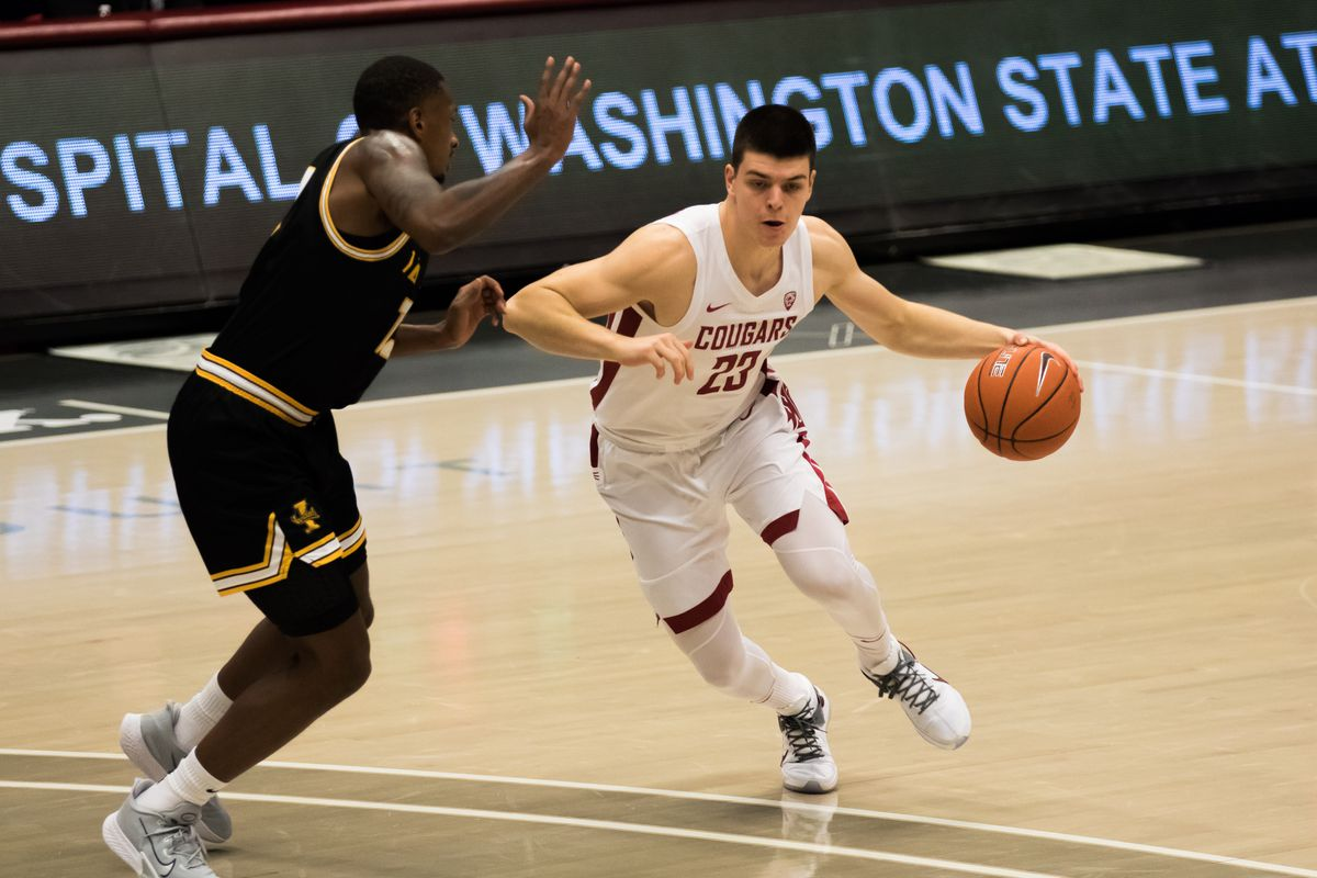 PULLMAN, WA - DECEMBER 9: Washington State forward Andrej Jakimovski (23) gets physical on offense during the first half of the Battle of the Palouse rivalry between the Idaho Vandals and the Washington State Cougars on December 9, 2020, at Beasley Coliseum in Pullman, WA.