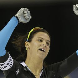 Brittany Bowe, of the United States, celebrates after the women's 1,000-meter competition at the World Cup speedskating event Sunday, Nov. 17, 2013, in Kearns, Utah. Bowe came in first place.