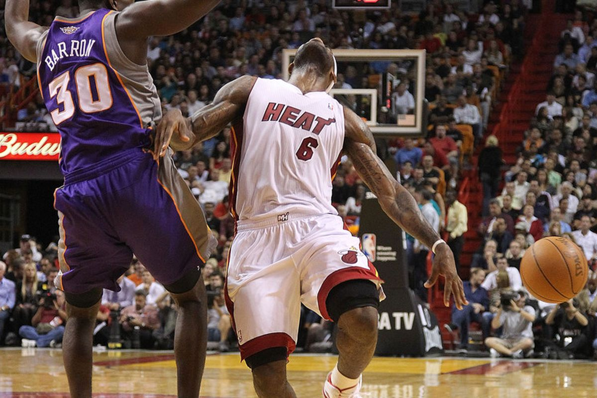 LeBron James flops after being fouled by Earl Barron during Phoenix Suns game versus the Miami Heat. (Photo by Mike Ehrmann/Getty Images)