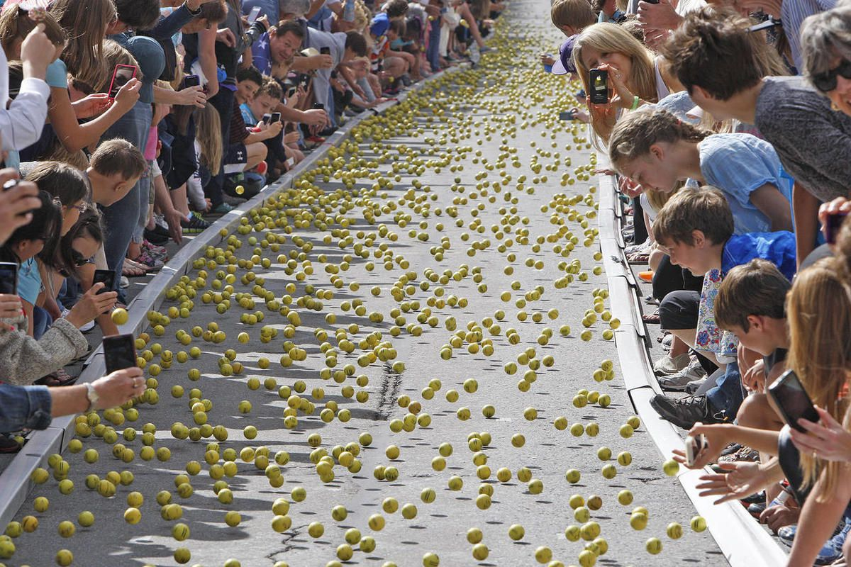 """Thousands of golf balls for charity roll down Main Street as the Park City area celebrates the Annual Miner's Day and the """"Running of the Balls"""" along with other Labor Day celebrations Monday, Sept. 2, 2013, in Park City."""