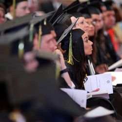 Graduates listen to the commencement address during LDS Business College's 126th commencement ceremony in the Tabernacle on Temple Square in Salt Lake City on Friday, April 12, 2013.
