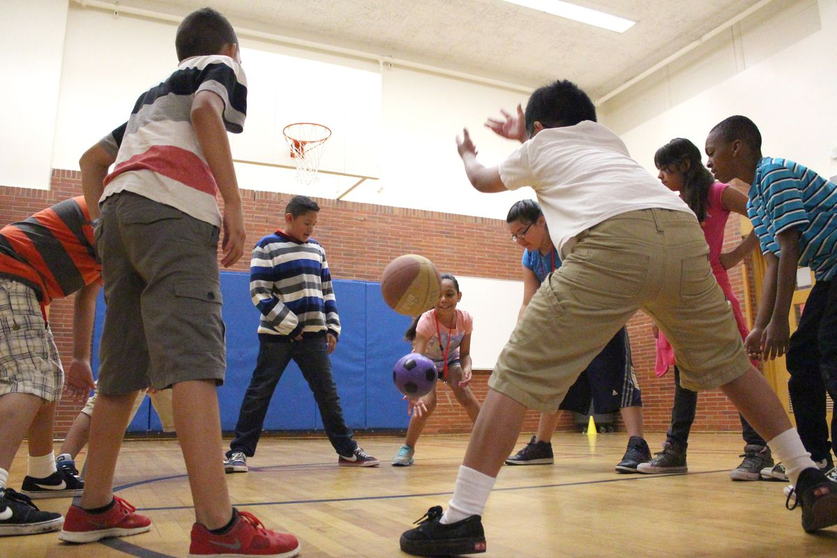 Students practiced their goalie skills by standing in a circle and trying to stop the balls from passing between their feet. This activity was offered by YMCA.