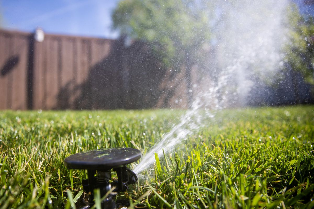 Sprinklers water a lawn in Salt Lake City. Utah Gov. Spencer Cox has issued his third water restriction in four months.