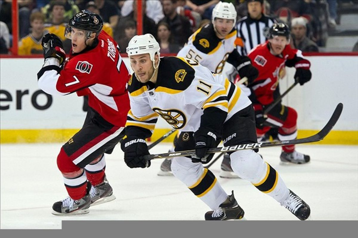Feb 25, 2012; Ottawa, ON, CAN; Boston Bruins centre Gregory Campbell (11) skates with Ottawa Senators Pdefenseman Kyle Turris (7) in the first period at Scotiabank Place. Mandatory Credit: Marc DesRosiers-US PRESSWIRE