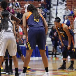 San Antonio Stars' Moriah Jefferson (4) and Connecticut Sun's Morgan Tuck (33) guard each other on the opening tap.