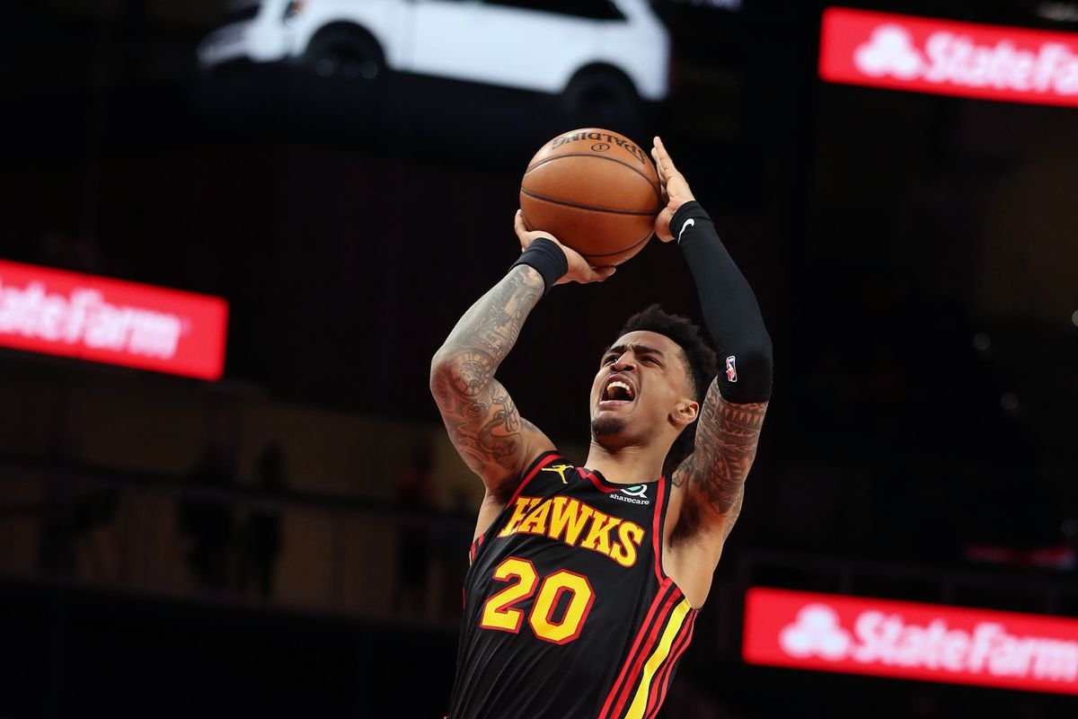 John Collins #20 of the Atlanta Hawks shoots the ball against the Houston Rockets on May 16, 2021 at State Farm Arena in Atlanta, Georgia.