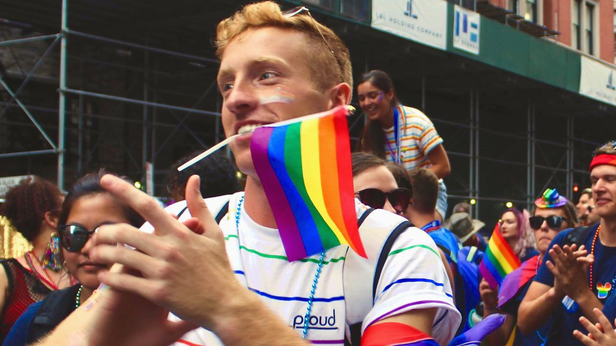 Josiah Davis marches with the Coast Guard contingent at World Pride in New York in 2019.
