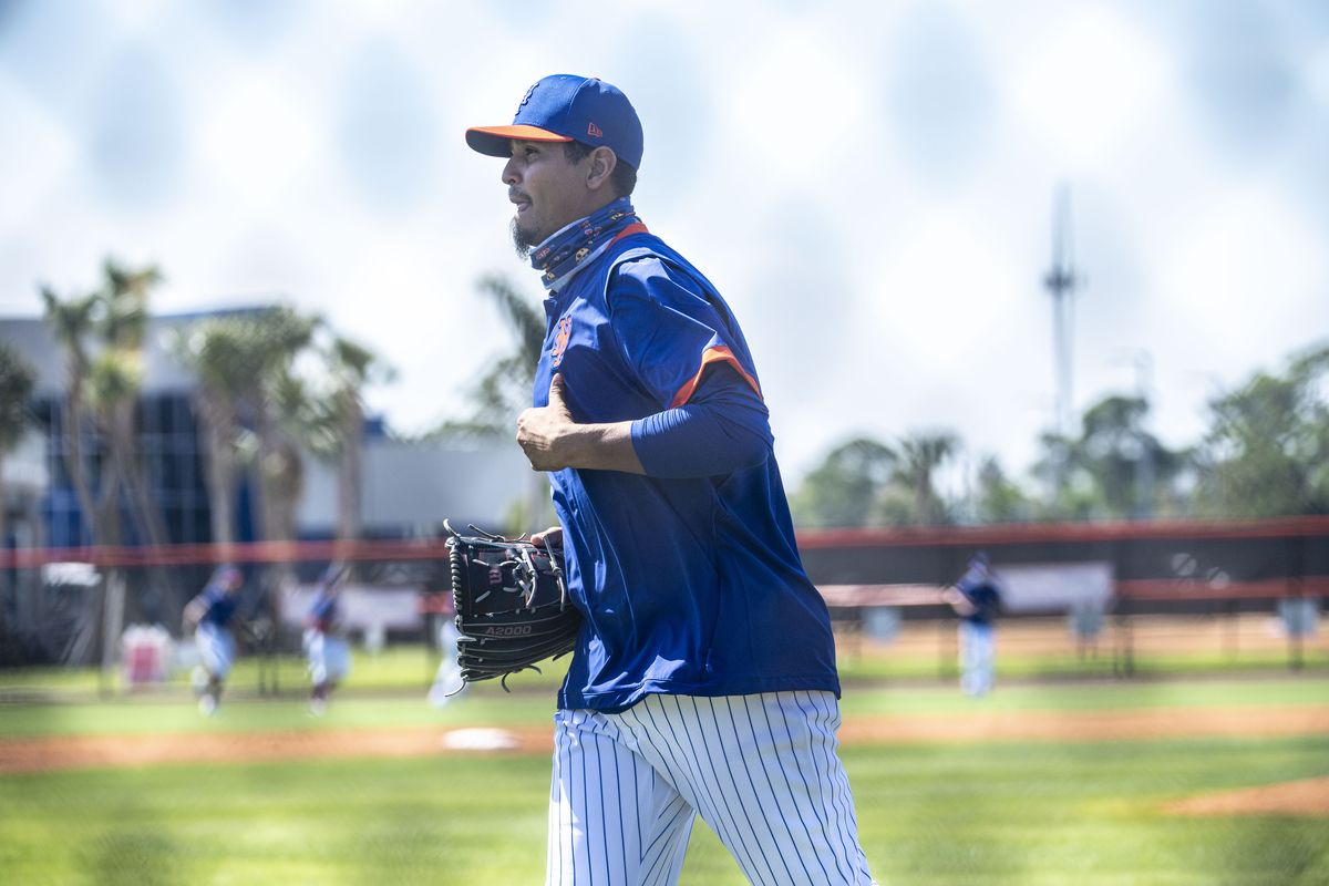 New York Mets pitcher Carlos Carrasco runs during a spring training drill in Port St. Lucie, Fla.