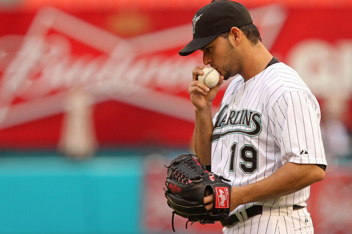 MIAMI GARDENS, FL - MAY 20: Anibal Sanchez #19 of the Florida Marlins kisses the ball during a game against the Tampa Bay Rays at Sun Life Stadium on May 20, 2011 in Miami Gardens, Florida. (Photo by Mike Ehrmann/Getty Images)