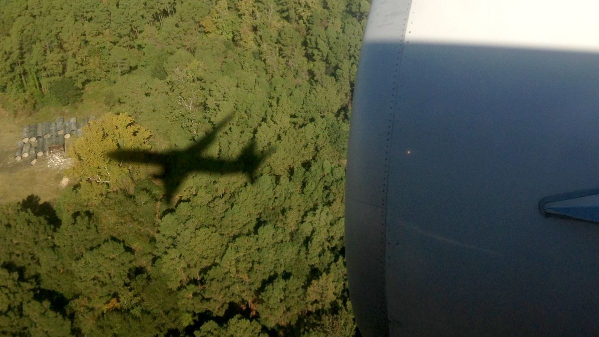 The shadow of the plane just before touchdown at Houston's busy George Bush Intercontinental Airport.