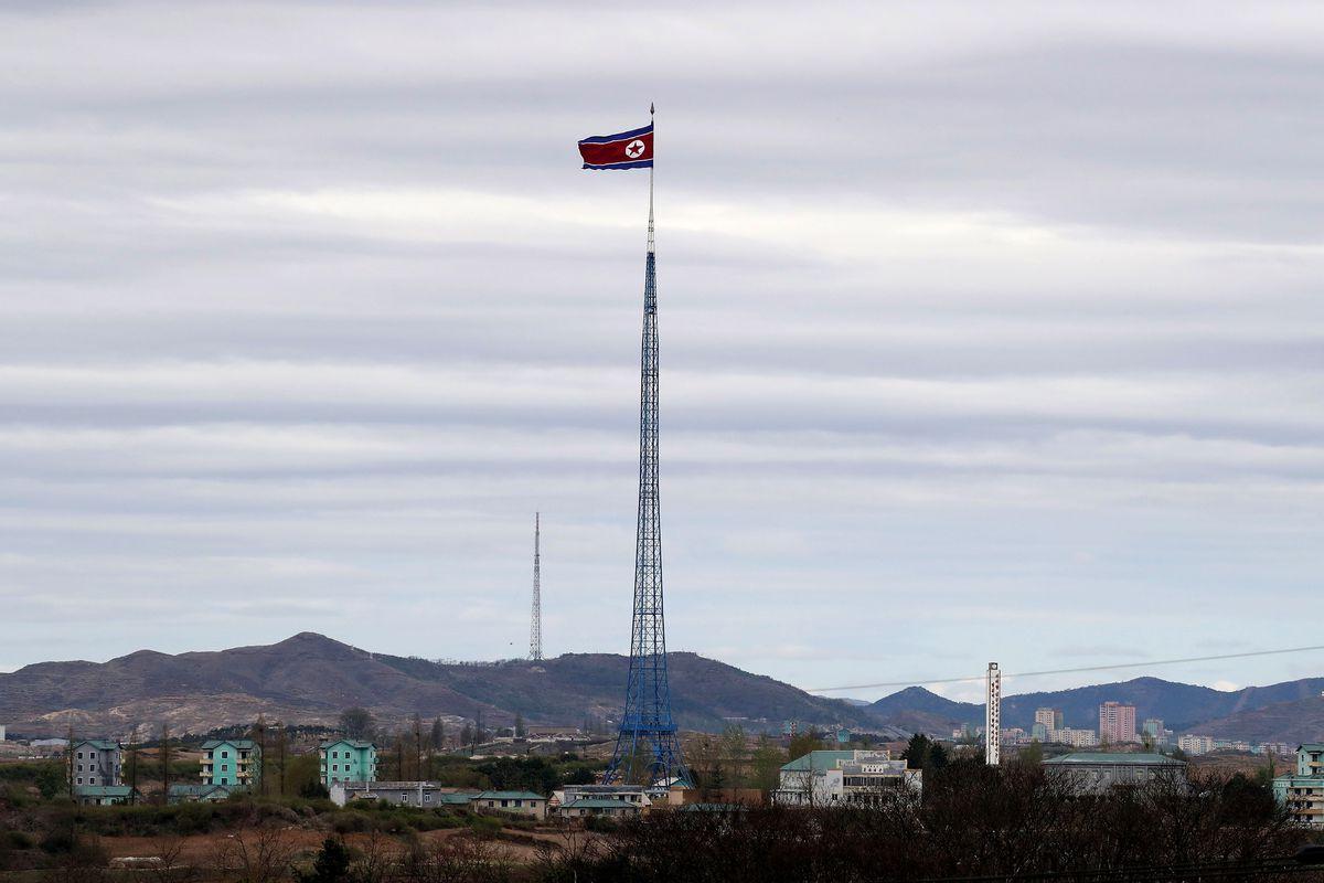 A North Korean national flag flies in North Korea's propaganda village near the Demilitarized Zone.