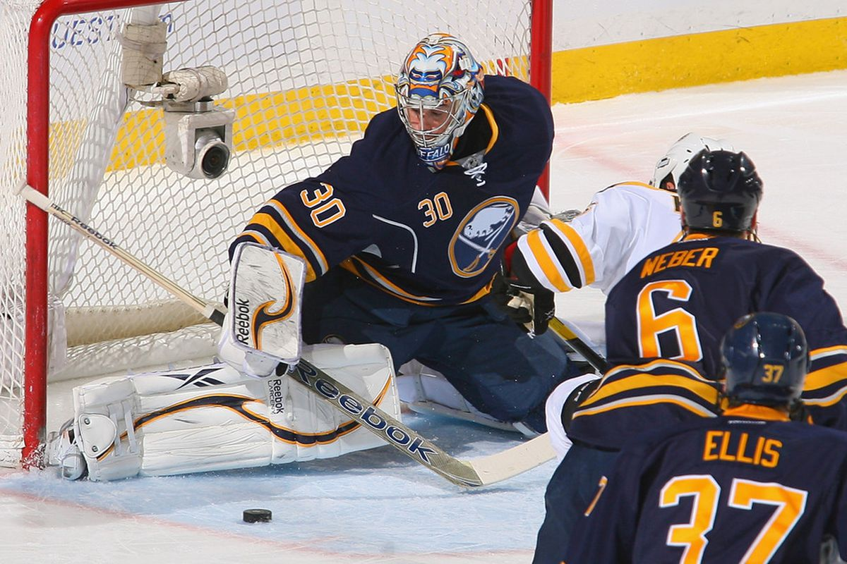 BUFFALO, NY - FEBRUARY 08: Ryan Miller #30 of the Buffalo Sabres makes a pad save on Nathan Horton #18 of the Boston Bruins in the first period at First Niagara Center on February 8, 2012 in Buffalo, New York.  (Photo by Rick Stewart/Getty Images)