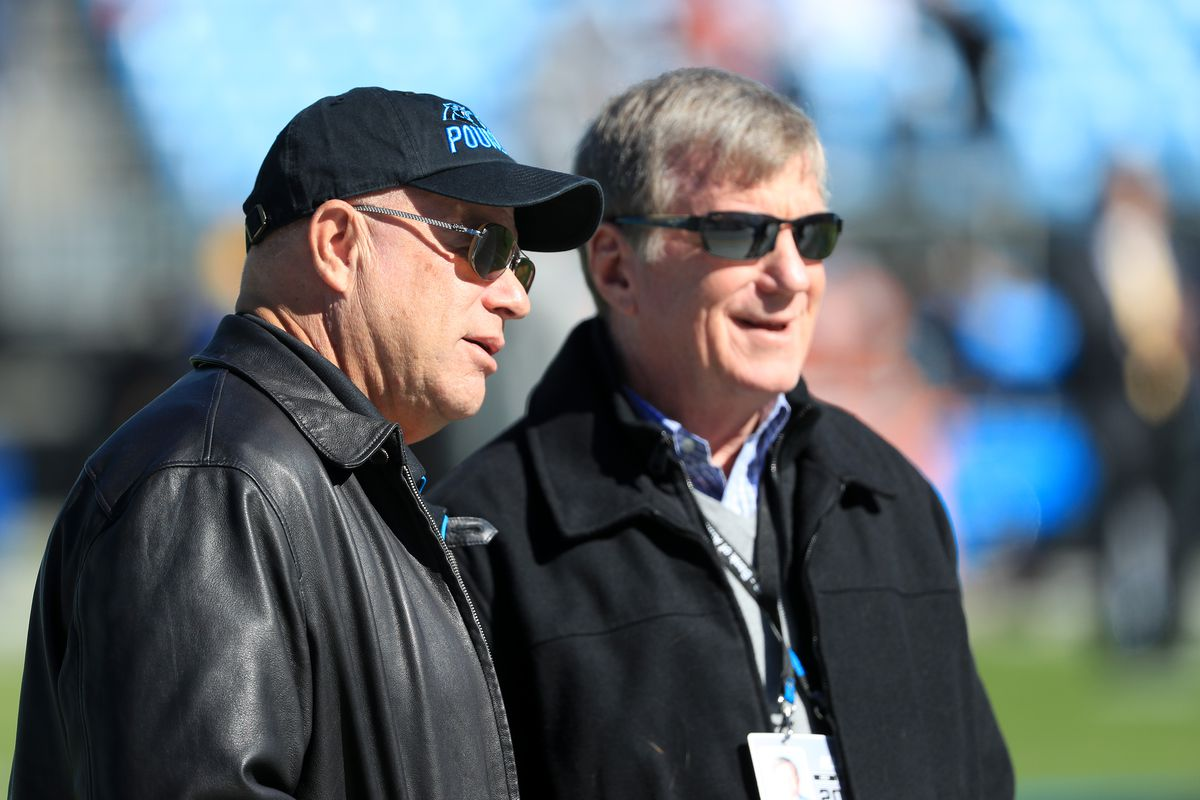 Team owner, David Tepper of the Carolina Panthers talks to Panthers General Manager, Marty Hurney, before their game against the Tennessee Titans at Bank of America Stadium on November 03, 2019 in Charlotte, North Carolina.