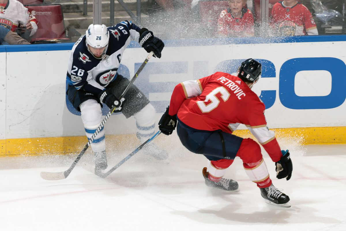 Alex Petrovic  6 of the Florida Panthers defends against Blake Wheeler  26  of the Winnipeg Jets during third period action at the BB T Center on  December 7 1b12771a3