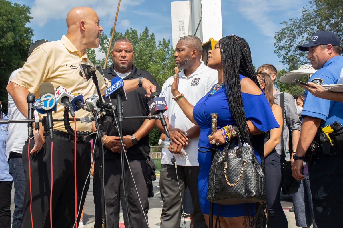 Correction Officers' Benevolent Association President Benny Boscio Jr. disrupts a rally organized by elected leaders outside Rikers Island to decry conditions in the jail complex, Sept. 13, 2021.