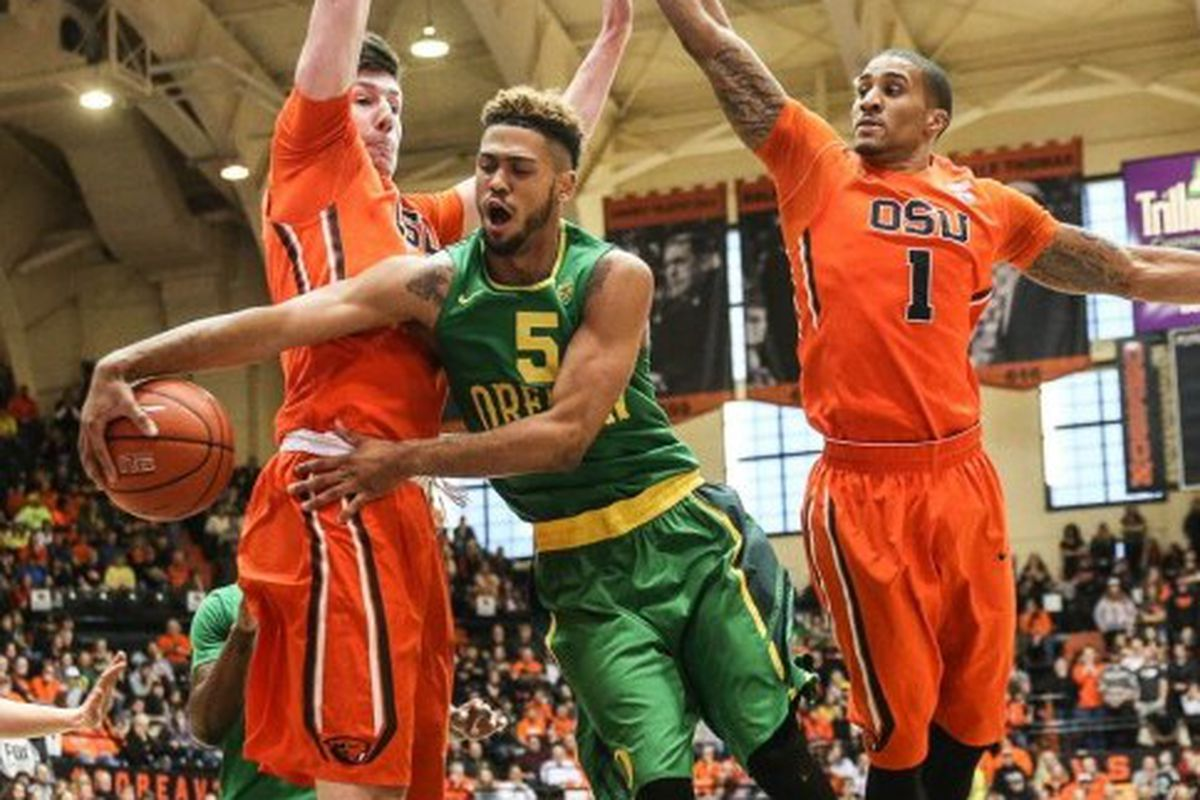 Oregon State's Drew Eubanks and Gary Payton II frustrate Oregon's Tyler Dorsey. It was typical of the Beavers' defensive effort against the Ducks