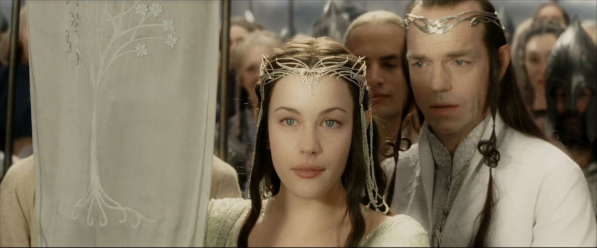 From behind his daughter, Hugo Weaving's Elrond looks at her with an absolutely devastated expression on his face in The Return of the King.